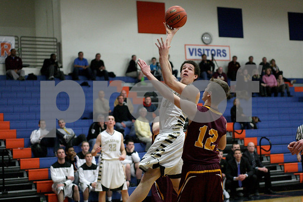 Monica Maschak - mmaschak@shawmedia.com<br /> Sycamore's Logan Wright jumps and shoots in the third quarter of the class 3A semifinal regional game against Montini Catholic on Tuesday, March 4, 2014. Sycamore won, 83-49.