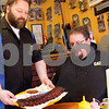 "Monica Maschak - mmaschak@shawmedia.com<br /> Owner Harlan ""Pork Chop"" Logan serves Chris Woods, of Hinckley, an order of ribs at South Moon Barbeque on Thursday, February 27, 2014. By mid-March, the barbecue shop will move to a bigger location down the road."