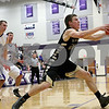Monica Maschak - mmaschak@shawmedia.com<br /> Sycamore's Ben Niemann strides with the ball in the first quarter of the class 3A sectional final against Rockford Lutheran at Hampshire High School on Friday, March 14, 2014. Sycamore lost 59-57.
