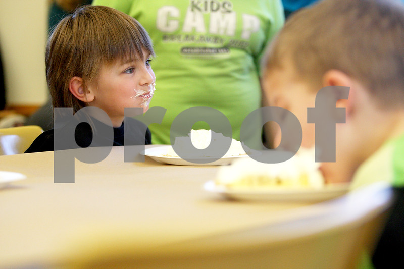 Monica Maschak - mmaschak@shawmedia.com<br /> Drew Sportsman, 5, looks up from consuming his piece of pie during a pie-eating contest in honor of Pi Day at Sycamore Library on Friday, March 14, 2014.