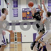 Monica Maschak - mmaschak@shawmedia.com<br /> Sycamore's Nicholas Feuerbach shoots the ball in the first quarter of the class 3A sectional final against Rockford Lutheran at Hampshire High School on Friday, March 14, 2014. Sycamore lost 59-57.