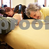 Monica Maschak - mmaschak@shawmedia.com<br /> Nancy Godfrey carefully puts away a piece of banana cream pie during a pie-eating contest in honor of Pi Day at Sycamore Library on Friday, March 14, 2014.