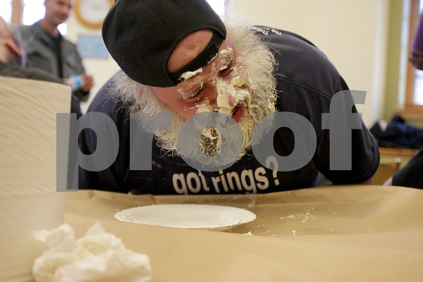 Monica Maschak - mmaschak@shawmedia.com<br /> D.J. Kurtzman cleans his plate of banana cream pie and gets first place during a pie-eating contest in honor of Pi Day at Sycamore Library on Friday, March 14, 2014.