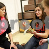 Monica Maschak - mmaschak@shawmedia.com<br /> McKenzie Bohlig (left), Sophie Melton and Lauren Jacobs plan out a way to cushion the egg's fall during the Science Olympiad at Sycamore Middle School on Thursday, March 13, 2014.