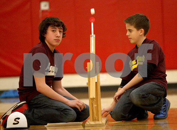 Monica Maschak - mmaschak@shawmedia.com<br /> Sixth graders Gavin Crofoot (left) and Nick Schumaker launch their marshmallow during the Science Olympiad at Sycamore Middle School on Thursday, March 13, 2014.