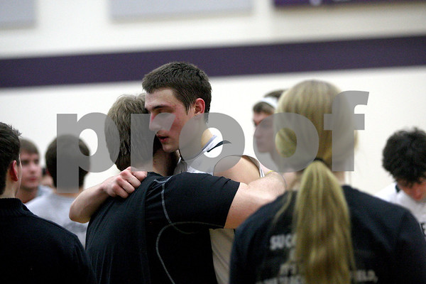 Monica Maschak - mmaschak@shawmedia.com<br /> Kaneland's John Pruett hugs a classmate after a 76-61 loss to Rockford Lutheran at Hampshire High School on Tuesday, March 11, 2014.