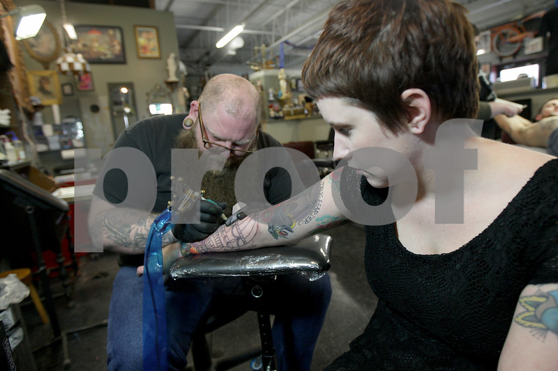 Monica Maschak - mmaschak@shawmedia.com<br /> Kayti Evans, 24, gets her eighteenth tattoo of a hot air balloon on her forearm from tatoo artist Mark Meyer at Proton Tattoo Shop on Friday, February 28, 2014.
