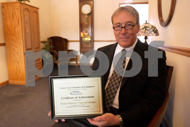 Monica Maschak - mmaschak@shawmedia.com<br /> Owner of Slater-Butala Funeral Home Michael G. Butala has been awarded a Certificate of Achievement from the Genoa Area Chamber of Commerce for running the family-owned business that has been open for 125 years.