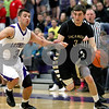 Monica Maschak - mmaschak@shawmedia.com<br /> Sycamore's Maxx Miller dribbles down court in the first quarter of the class 3A sectional final against Rockford Lutheran at Hampshire High School on Friday, March 14, 2014. Sycamore lost 59-57.
