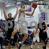 Monica Maschak - mmaschak@shawmedia.com<br /> Kaneland's John Pruett attempts a field goal in the first quarter against Rockford Lutheran at Hampshire High School on Tuesday, March 11, 2014.