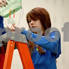 Monica Maschak - mmaschak@shawmedia.com<br /> Eighth grader Kristina Duncan prepares to drop an egg from the top of a ladder during the Science Olympiad at Sycamore Middle School on Thursday, March 13, 2014.