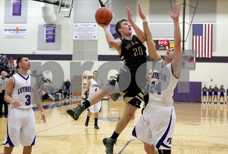 Monica Maschak - mmaschak@shawmedia.com<br /> Sycamore's Ben Niemann seeks the hoop in the third quarter of the class 3A sectional final against Rockford Lutheran at Hampshire High School on Friday, March 14, 2014. Sycamore lost 59-57.