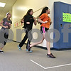 Monica Maschak - mmaschak@shawmedia.com<br /> From left: Eighth graders Autumn Whitner, Rocio Hernandez and Martha Naula? run in the hallways of Clinton Rosette Middle School at an after-school meeting for Barbs on The Run on Tuesday, March 11, 2014.