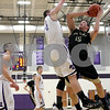 Monica Maschak - mmaschak@shawmedia.com<br /> Sycamore's Devin Mottet attempts a field goal in the first quarter of the class 3A sectional final against Rockford Lutheran at Hampshire High School on Friday, March 14, 2014. Sycamore lost 59-57.
