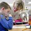 Monica Maschak - mmaschak@shawmedia.com<br /> Kindergarten teacher Marcy Billington talks to her student about his drawing of an adult he feels safe with during a sexual abuse prevention lesson at Davenport Elementary School on Monday, March 10, 2014.
