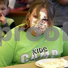 Monica Maschak - mmaschak@shawmedia.com<br /> Rachel McMahon, 12, gets more pie on her face than in her mouth during a pie-eating contest in honor of Pi Day at Sycamore Library on Friday, March 14, 2014.