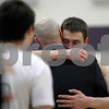 Monica Maschak - mmaschak@shawmedia.com<br /> Kaneland's John Pruett hugs head coach Brian Johnson after his last play in the fourth quarter against Rockford Lutheran at Hampshire High School on Tuesday, March 11, 2014. Kaneland lost, 76-61.