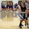 Monica Maschak - mmaschak@shawmedia.com<br /> Sycamore's Jacob Winters looks to pass in the third quarter of the class 3A sectional final against Rockford Lutheran at Hampshire High School on Friday, March 14, 2014. Sycamore lost 59-57.