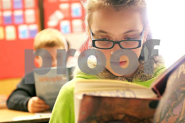Danielle Guerra - dguerra@shawmedia <br /> Fifth-graders Ashley Petricig (right), 11, and Joshua King, 11, both read at their desks Thursday at Tyler Elementary in DeKalb.