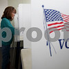 Monica Maschak - mmaschak@shawmedia.com<br /> Teri Price, of Sycamore, cast her ballot during the early voting period at the DeKalb County Administrative Building on Friday, March 7, 2014.