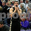 Monica Maschak - mmaschak@shawmedia.com<br /> Sycamore's Devin Mottet bites his jersey fearing the outcome of the game in the fourth quarter of the class 3A sectional final against Rockford Lutheran at Hampshire High School on Friday, March 14, 2014. Sycamore lost 59-57.