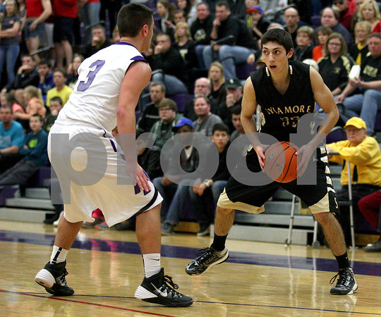 Monica Maschak - mmaschak@shawmedia.com<br /> Sycamore's Mark Skelley surveys the court in the second quarter of the class 3A sectional final against Rockford Lutheran at Hampshire High School on Friday, March 14, 2014. Sycamore lost 59-57.