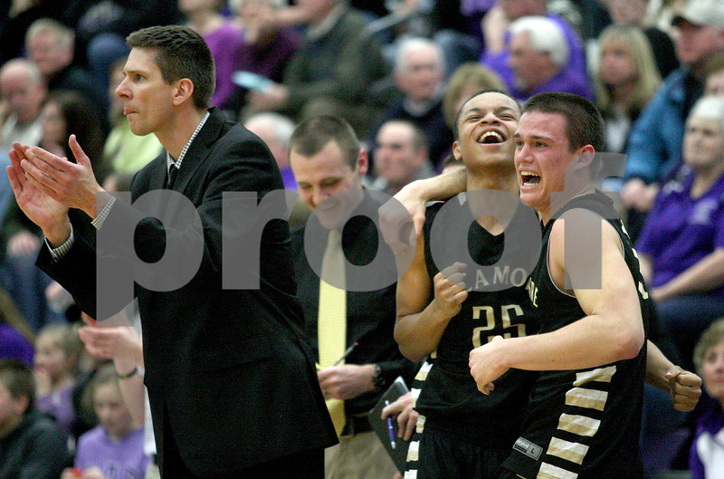 Monica Maschak - mmaschak@shawmedia.com<br /> Sycamore's head coach Andrew Stacy and players Daniel Evans and Devin Mottet celebrate a slight lead in the fourth quarter of the class 3A sectional final against Rockford Lutheran at Hampshire High School on Friday, March 14, 2014. Sycamore lost 59-57.