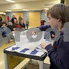 Monica Maschak - mmaschak@shawmedia.com<br /> Seventh grader Nicholas Merryman drops tiny weights into his handmade boat until it sinks during the Science Olympiad at Sycamore Middle School on Thursday, March 13, 2014.