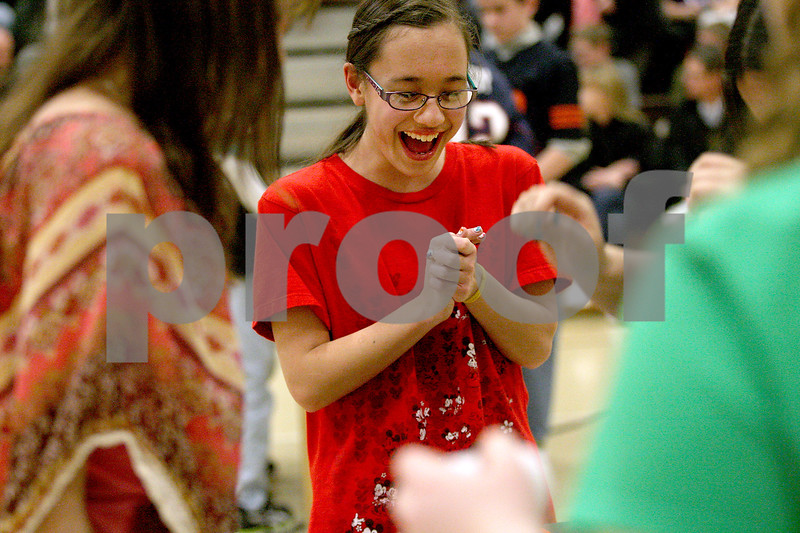 "Monica Maschak - mmaschak@shawmedia.com<br /> Eighth grader Kate Umekubo laughs as she and her team put together an obstacle for the ""rollie pollie"" event of the Science Olympiad at Sycamore Middle School on Thursday, March 13, 2014."