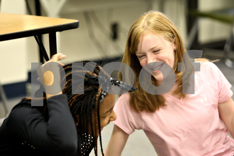 Monica Maschak - mmaschak@shawmedia.com<br /> Madison Boston (left) and Abby Hanlon, both in sixth grade, laugh during an activity at an after-school meeting for Barbs on The Run at Clinton Rosette Middle School on Tuesday, March 11, 2014.
