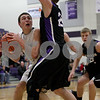Monica Maschak - mmaschak@shawmedia.com<br /> Kaneland's John Pruett peers out from behind a defender in the second quarter against Rockford Lutheran at Hampshire High School on Tuesday, March 11, 2014.