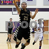 Monica Maschak - mmaschak@shawmedia.com<br /> Sycamore's Daniel Evans puts one up in the second quarter of the class 3A sectional final against Rockford Lutheran at Hampshire High School on Friday, March 14, 2014. Sycamore lost 59-57.