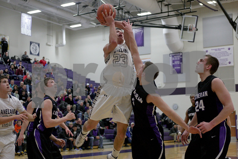 Monica Maschak - mmaschak@shawmedia.com<br /> Kaneland's Tyler Carlson takes a shot at the hoop in the second quarter against Rockford Lutheran at Hampshire High School on Tuesday, March 11, 2014.
