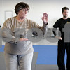 Monica Maschak - mmaschak@shawmedia.com<br /> Deb Paulin (left) goes through the memorized motions with Sifu Tom Scott behind his students during a Tai Chi class at Hero Martial Arts in DeKalb Thursday, March 13, 2014.