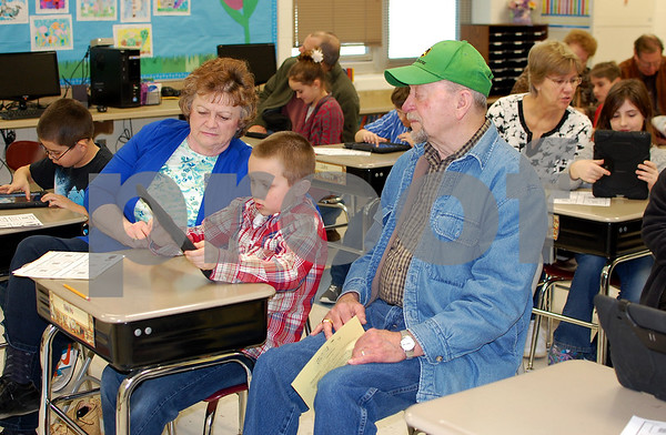 Debbie Behrends - dbehrends@shawmedia.comHelene and Jim Parker of Rockford played a game on an iPad with their grandson, Drake Prestgaard, at Shabbona Elementary School on Friday, March 21. Helene Parker said they haven't missed a Grandparents' Day.