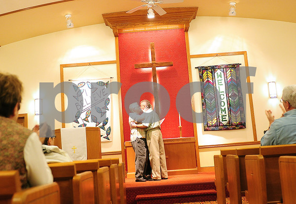 Danielle Guerra - dguerra@shawmedia   Darla Cook (left) and Jaelyn Paulsen (right) share their first kiss as they were pronounced wife and wife by Rev. Dr. Martha Brunell at the Mayfield Congregational Church UCC in Sycamore Monday night.  Cook and Paulsen were issued the first same sex marriage license in DeKalb County last Thursday.
