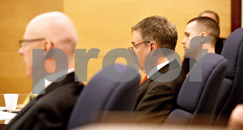 Monica Maschak - mmaschak@shawmedia.com<br /> From left: Assistant State's Attorney Joseph Cullen, Defense Attorney D.J. Tegeler, and defendant Benjamin Black listen to witnesses during a sentencing hearing for Black at the Kane County Courthouse on Thursday, March 20, 2014. Black is convicted of aggravated driving under the influence in a 2013 crash that killed a Sycamore boy. The judge delayed the sentencing to March 26.