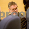 Monica Maschak - mmaschak@shawmedia.com<br /> Defense Attorney D.J. Tegeler peers behind him during a sentencing hearing for Benjamin Black at the Kane County Courthouse on Thursday, March 20, 2014. The judge delayed the sentencing to March 26.