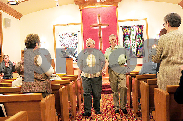Danielle Guerra - dguerra@shawmedia   Darla Cook and Jaelyn Paulsen were introduced for the first time as wife and wife after they were married in a small ceremony officiated by Rev. Dr. Martha Brunell at the Mayfield Congregational Church UCC in Sycamore Monday night.
