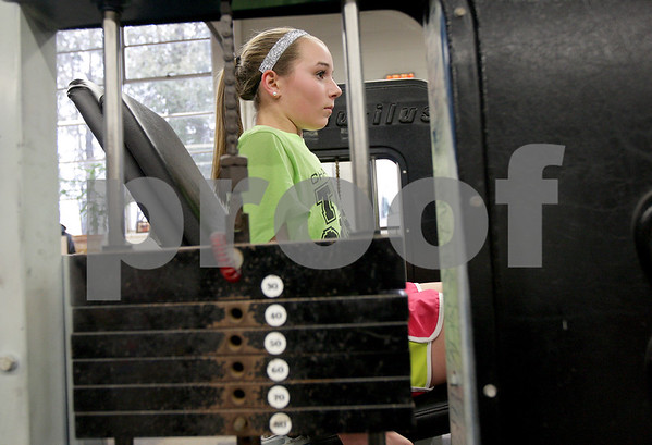 Monica Maschak - mmaschak@shawmedia.com<br /> Indian Creek junior Emily Schilling does leg extensions during track practice at Indian Creek Middle School on Wednesday, March 19, 2014. Schilling took 7th in the 800 and 5th in the 1,600 as a sophomore at the state finals last year.