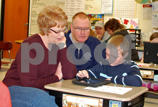 Debbie Behrends - dbehrends@shawmedia.comPam and Frank Ottengheime of Shabbona played a game on an iPad with their grandsons, Blake McRoberts, during Grandparents' Day on Friday, March 21 at Shabbona Elementary School. Pam Ottengheime said next year Blake will have to share them with his younger sister when she enters kindergarten.