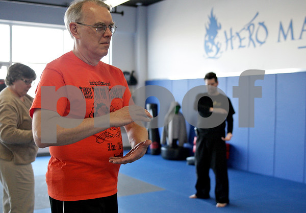 Monica Maschak - mmaschak@shawmedia.com<br /> Jim Paulin (left) follows the motions of Sifu Tom Scott during a Tai Chi class at Hero Martial Arts in DeKalb Thursday, March 13, 2014.