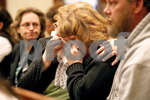 Monica Maschak - mmaschak@shawmedia.com<br /> Tonda Ranken, mother of Matthew Ranken, cries with her mother (left), Arlene Scott, during a sentencing hearing for Benjamin Black at the Kane County Courthouse on Thursday, March 20, 2014. The judge delayed the sentencing to March 26.