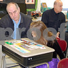 Debbie Behrends - dbehrends@shawmedia.comBob Wortman of Montgomery reads about Earth Day with his granddaughter, Emily Wortman, at Shabbona Elementary School on Friday, March 21. Wortman, along with about 300 other grandparents, visited the school during the annual Grandparents' Day.