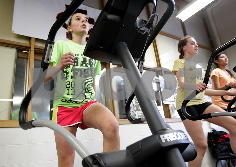 Monica Maschak - mmaschak@shawmedia.com<br /> Indian Creek junior Emily Schilling warms up on the elliptical during track practice at Indian Creek Middle School on Wednesday, March 19, 2014. Schilling took 7th in the 800 and 5th in the 1,600 as a sophomore at the state finals last year.