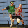 Danielle Guerra - dguerra@shawmedia.com   Genoa-Kingston junior midfielder Nicole Hebel (left) tries to control the ball with pressure from teammate junior Katie McCluskey Tuesday morning at practice.