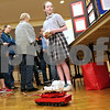 Monica Maschak - mmaschak@shawmedia.com<br /> Halle Martin, 12, a seventh grader at St. Mary's School in Sycamore, controls her Automated Remote Controlled Hazardous Entry Equipment (ARCHEE) during the 2014 Illinois Junior Academy of Science – Northern Region V Science Fair Regional Project Session Semi-Finals at the Holmes Student Center at Northern Illinois University on Saturday, March 22, 2014. The Genoa-Kingston Fire Department allowed Martin to use their facilities to test her project and insured her safety in doing so. ARCHEE is designed to put out fires.