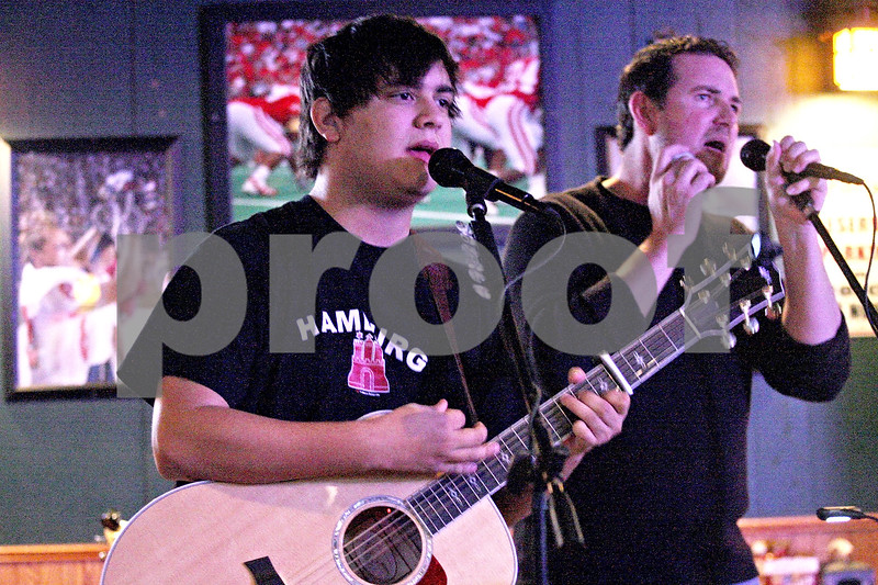Monica Maschak - mmaschak@shawmedia.com<br /> Luke Underhill (left), 18, of Yorkville, performs with mic night host Marc Hanson during Open Mic Night at Fatty's in DeKalb on Monday, March 24, 2014. This was Underhill's first time performing at Fatty's.