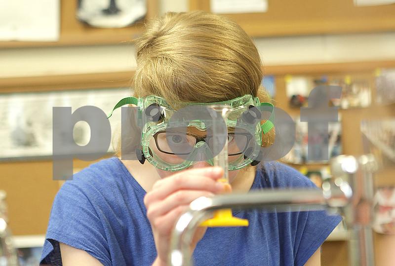Danielle Guerra - dguerra@shawmedia  Alayna Gersic, a senior is Isabelle Kovarik's AP chemistry class, double checks her measurement during an equilibrium lab Tuesday at DeKalb High School.