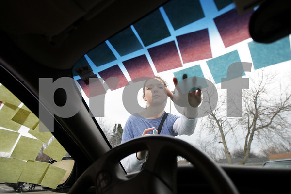 Monica Maschak - mmaschak@shawmedia.com<br /> Emily Comer, freshman at University of Iowa and Sycamore alumna, puts sticky notes all over boyfriend and Sycamore junior Justin Otte's car as a creative way to ask him to Sycamore's Turnabout - a Sadie Hawkins-type dance - while Otte was at track practice on Friday, March 21, 2014.